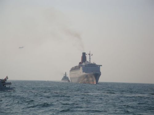 QE2 trailed by HMS Lancaster and saluted by an A380 Flypast